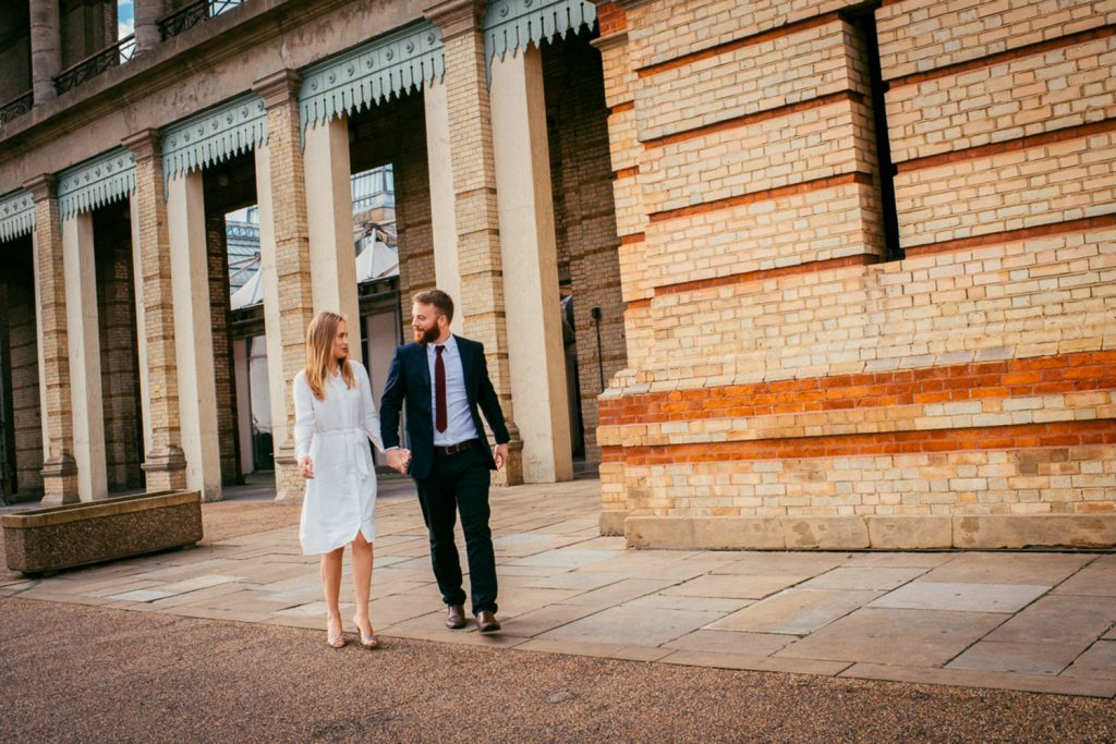 Couple walking in front of Alexandra Palace London