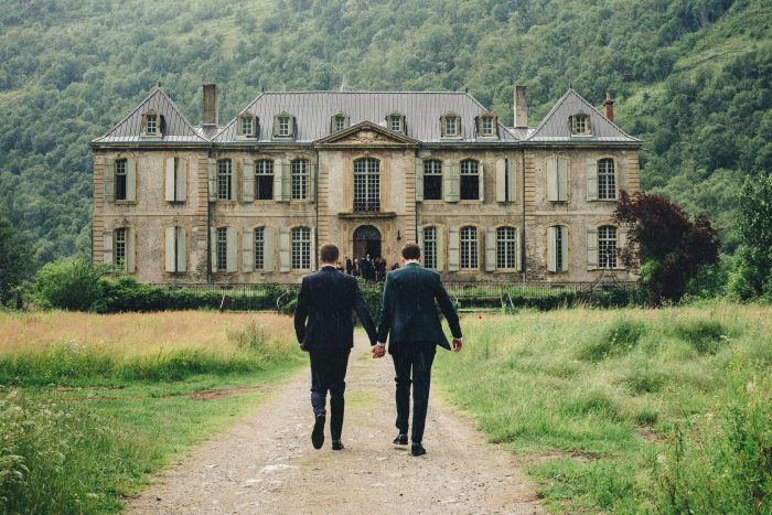 Dan and Carl walking to Chateau Gudanes getting married