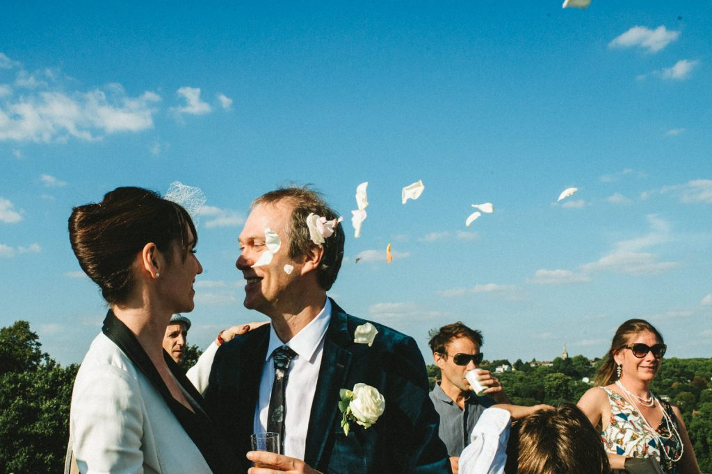 Flower petal in the air maried couple kiss