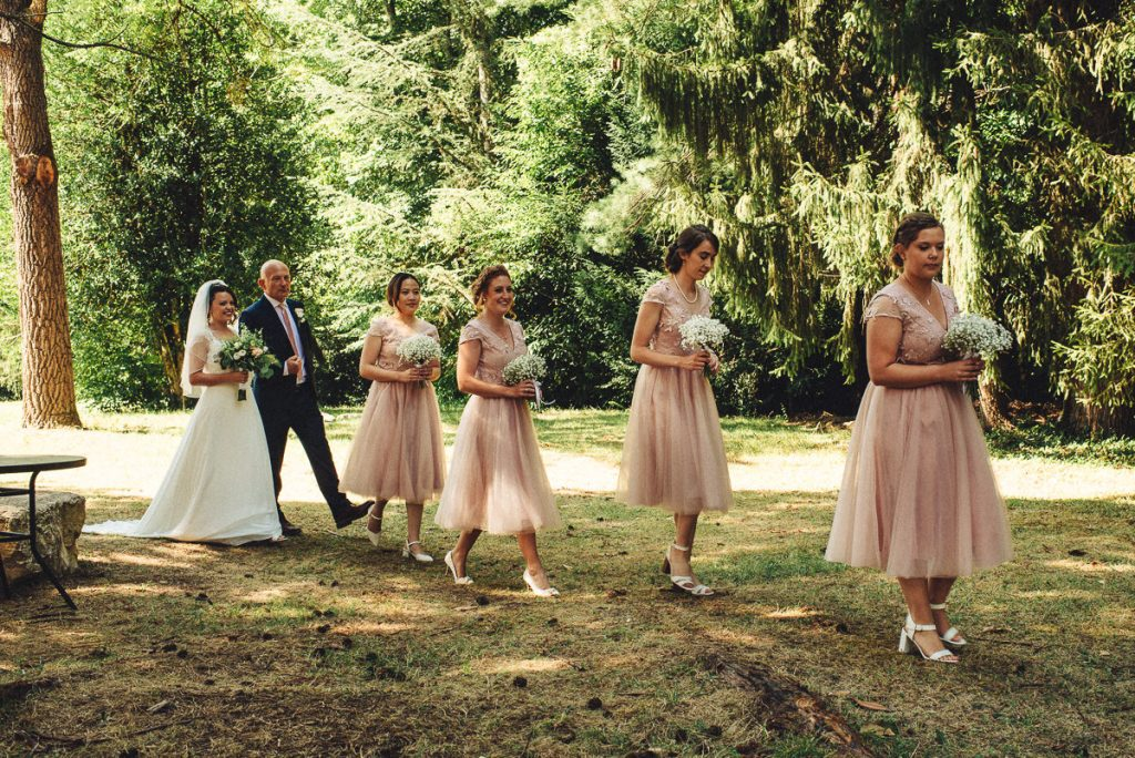 bride and bridemaids walking to ceremony at Chateau Saint Michel South of France