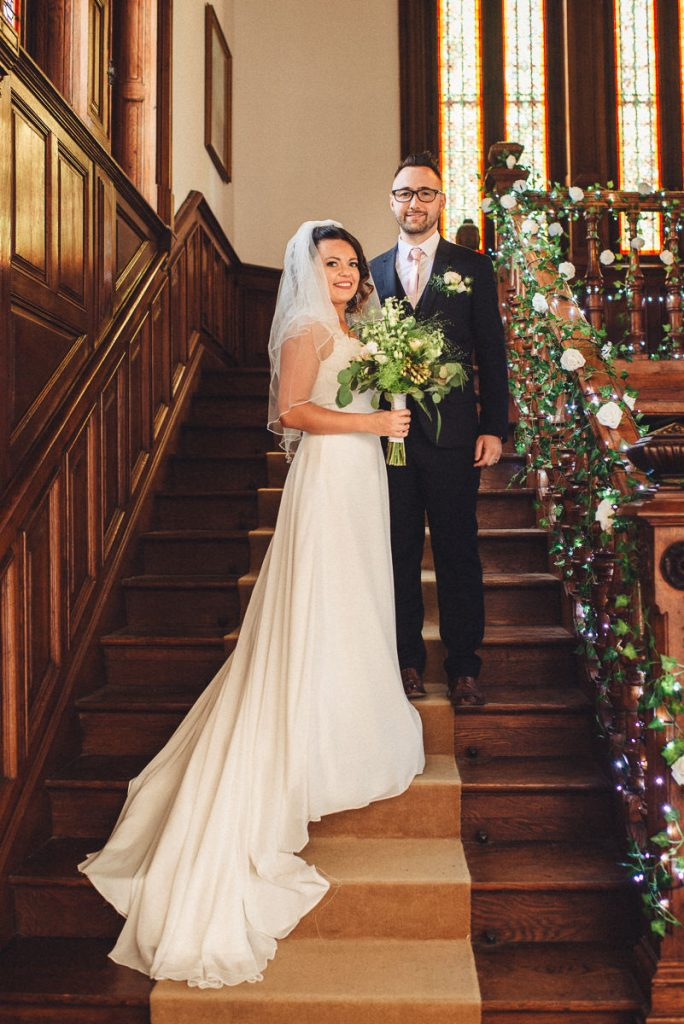 Emily Florent Married couple in grand staircase at Chateau Saint Michel South of France