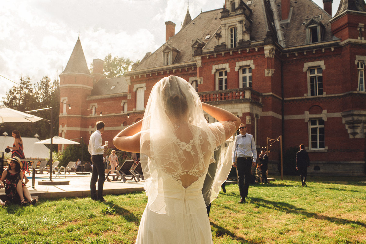 Emily looking back into the sun at Chateau Saint Michel on her wedding day